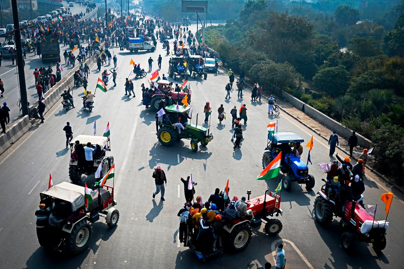 Indian farmers bring park their tractors blocking streets to new delhi